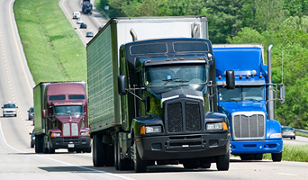 Commercial Trucks Driving on Interstate