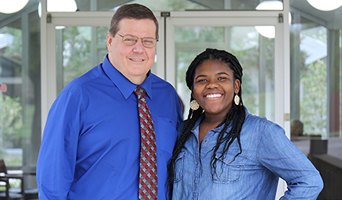 Photo of NFCC President John Grosskopf and Student Monica Powe